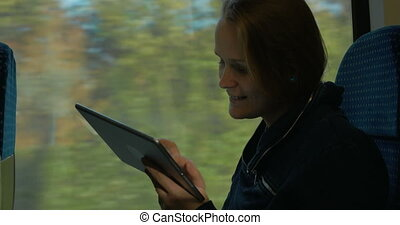 Woman Staying in Touch on the Way - Young woman is staying...