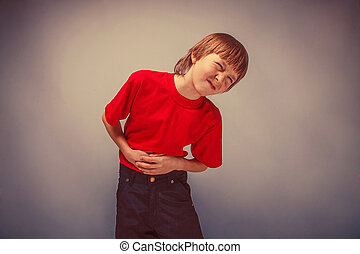 Boy teenager twelve years in red shirt abdominal pain,...