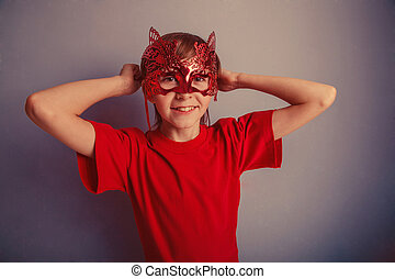Boy teenager twelve years in the red shirt in the mask,...