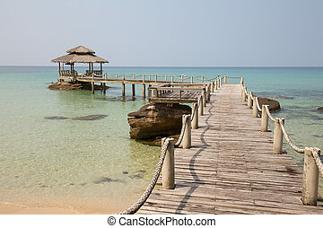 Tropical beach and quay pier in island Koh Kood , Thailand -...