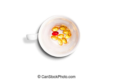 cup with red and yellow pills - White cup filled with red...