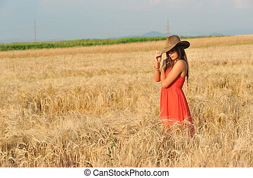young woman in yellow wheat field
