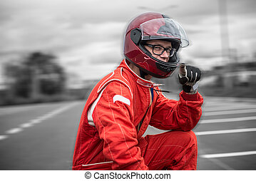 Race car driver - Closeup race car driver wearing protective...