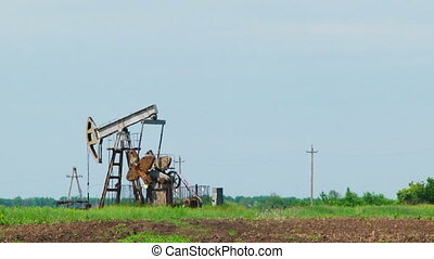 Oil Pump Digging While Producing Natural Gas At Dusk - Low...