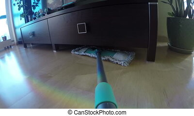 man wash floor with broom - Wooden floor laminate cleaning...