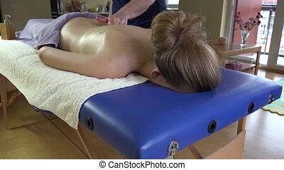 man massage woman back