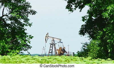 Oil Pump Drilling While Producing Natural Gas - Low angle...