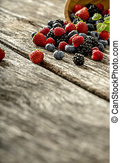 Fresh berries spilling from a bowl