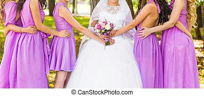 bridesmaids - Row of bridesmaids at wedding ceremony. Bride...