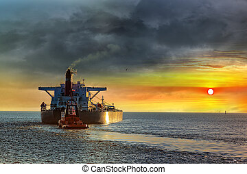 Seascape - Tanker ship on sea in the rays of the setting...