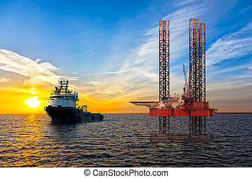 Oil industry - Tugboat and Oil Platform on offshore area at...