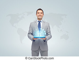 businessman with shopping cart over tablet pc - business,...