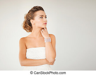woman with pearl earrings and bracelet - beautiful bride...