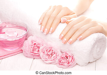 french manicure with rose flowers. spa - beautiful french...