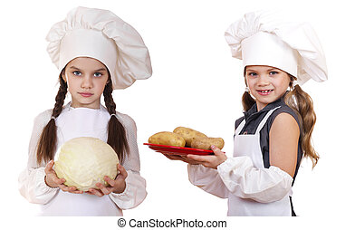 Cooking and people concept - Two Little girls in a white...