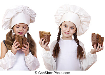 Cooking and people concept - Two little girls in cook hat -...