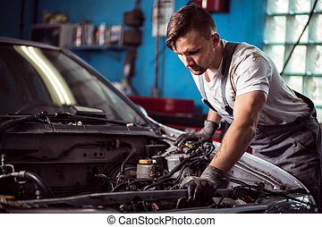 Worker of service station repairing - Photo of handsome...