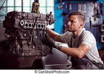 Car technician maintaining automotive engine - Photo of...