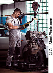 Auto mechanic inspecting motor car - Picture of auto...