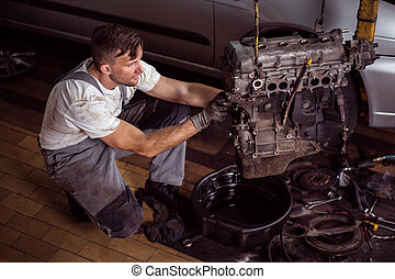Service station worker repairing motor - Photo of handsome...