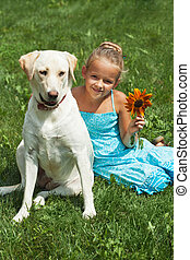 Young girl sitting with her dog
