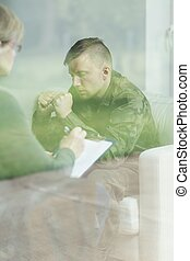 Therapy of psychical trauma - Despair soldier during therapy...