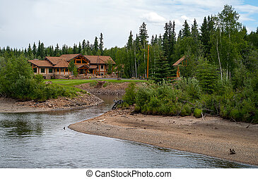 Log Home along the river in Alaska near Fairbanks