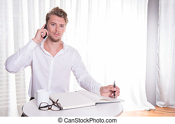 young business man in smart casual on the phone