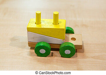 Colorful Wooden Train Toy - Close up view of multicolored...