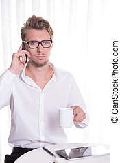 young business man  on the phone looking scared