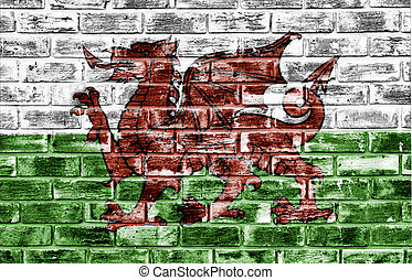 Welsh flag on a rough textured surface - Welsh flag applied...