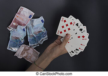 wasting money playing cards - card player, waste money