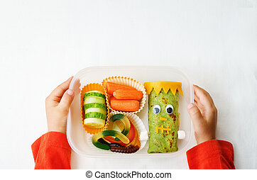 childrens hands holding lunch box for Halloween - childrens...