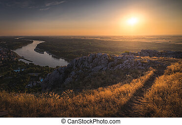 Sunset over the Rocks and the River - Landscape. Beautiful...