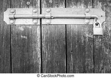Old latch of a main door - Old latch of a wooden door of a...