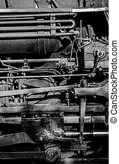 Steam Engine Pipes - A close up of a train engine in black...