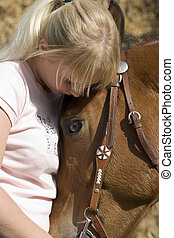 love - blond woman with her own brown horse