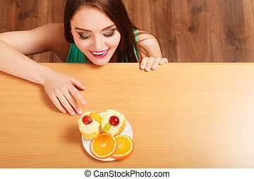 Woman looking at delicious sweet cake. Gluttony. - Woman...
