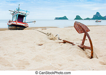 Old Anchor on the beach with ship and sea background as horizontal
