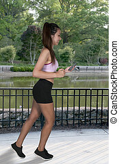 Woman Jogger - Beautiful woman jogging for health and...