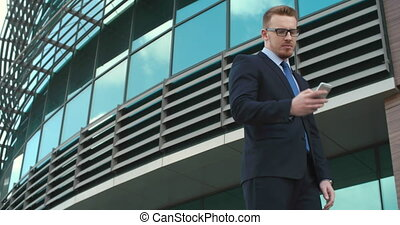 Making Business Call - Young businessman in eyeglasses...