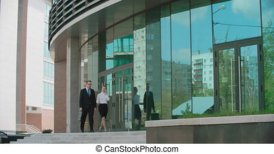 Walking to Lunch Together - Business partners talking while...