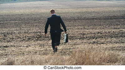 Feeling Carefree - Carefree businessman skipping through...