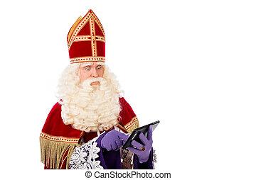 Sinterklaas with tablet - Sinterklaas looking on tablet....