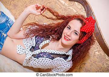 Happy red head lady playing with long wavy hair relaxing -...
