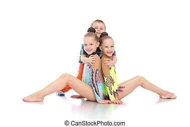 Boy hugging girls gymnasts