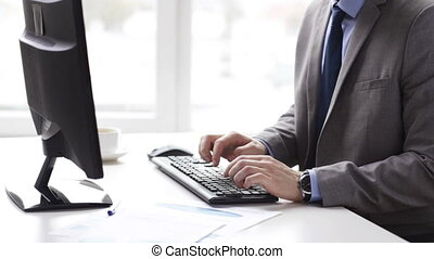 close up of businessman typing and drinking coffee - people,...