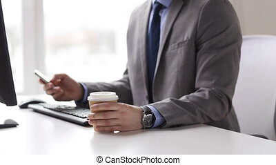 close up of businessman with smartphone and coffee - people,...