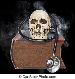 skull and stethoscope on old text book