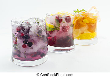 Three non alcoholic fruit cocktails with iced and sliced...